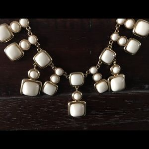 Cream & gold-tone statement necklace.